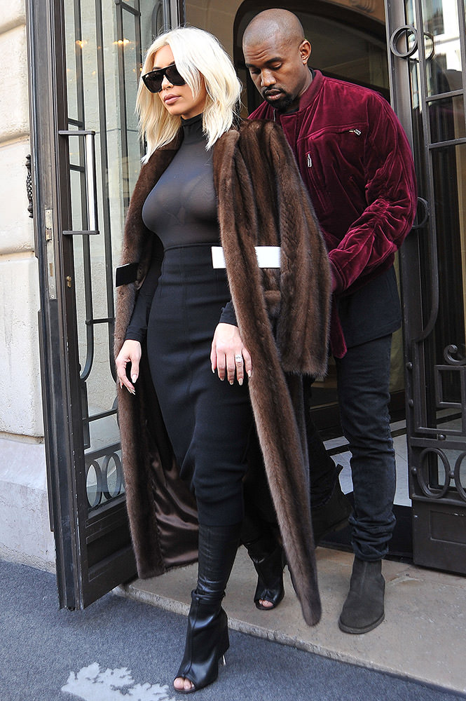 INF - Kim Kardashian And Kanye West Make a Pit Stop At Their Hotel