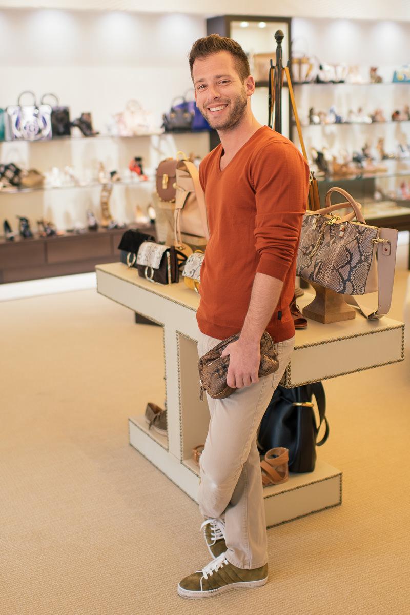 Hugo Boss Sweater, shop similar styles via Nordstrom. AG Denim Pants, shop similar styles via Nordstrom. Berlutti shoes, via Mr. Porter. Capretto 'Take Me With You Pouch', via Capretto.