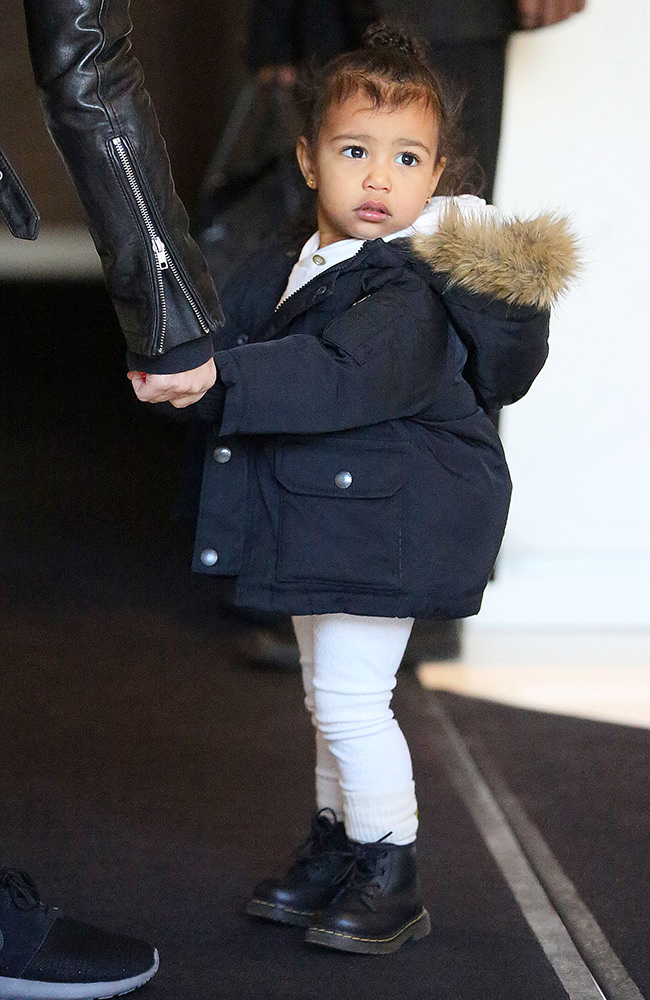 Kim Kardashian and North West return to their apartment with their iPad in NYC