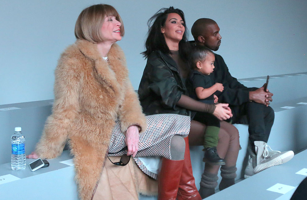 Kim Kardashian, Kanye West, and daughter all chat with Anna Wintour and watch his fashion show NYC