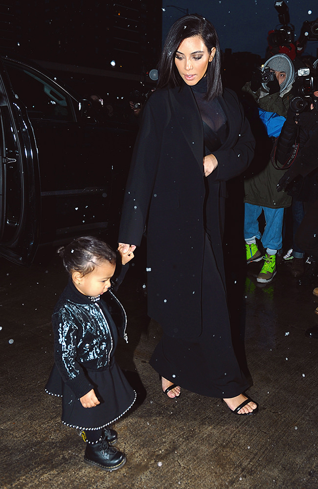 Kim Kardashian and daughter North West spotted leaving their NYC apartment building.