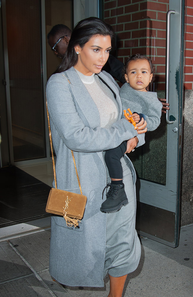 Kim Kardashian and North West leaving their apartment together in New York City