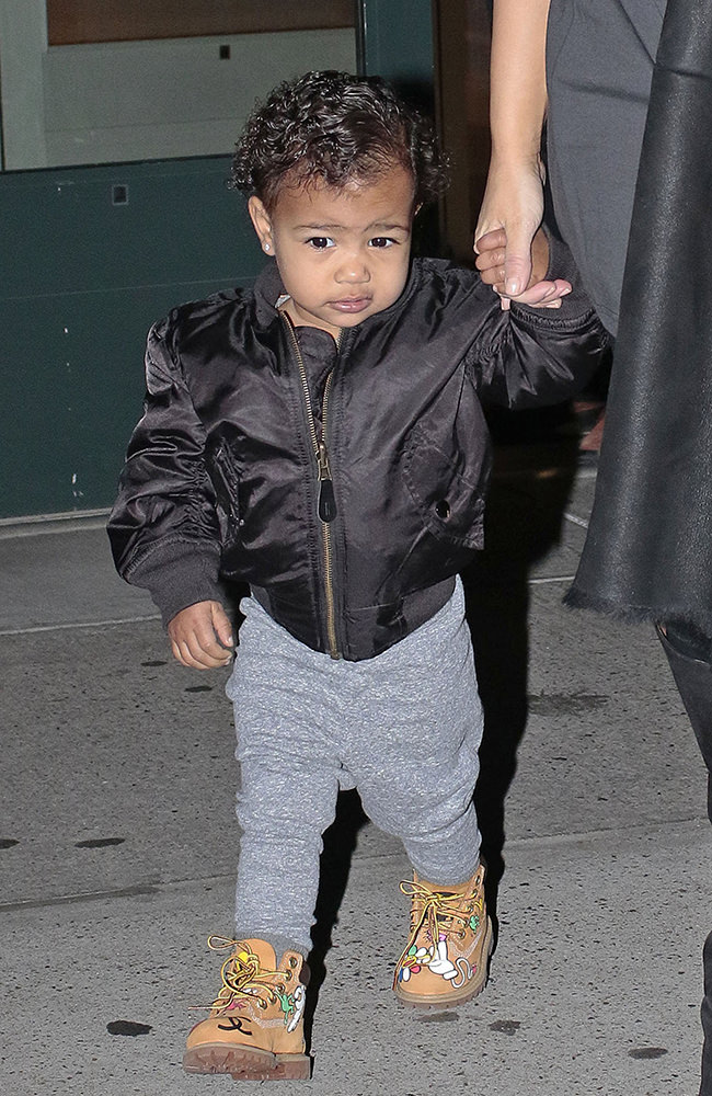 Kim Kardashian walks baby North West outside their apartment in New York City