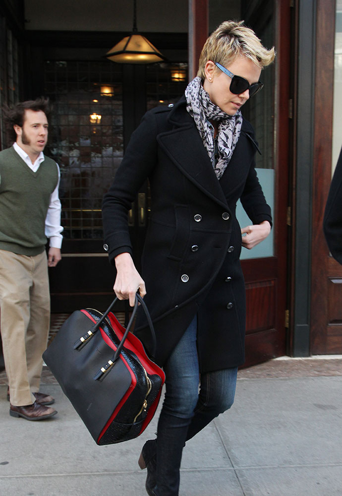 14f5ff382393 The Many Bags of Charlize Theron - PurseBlog