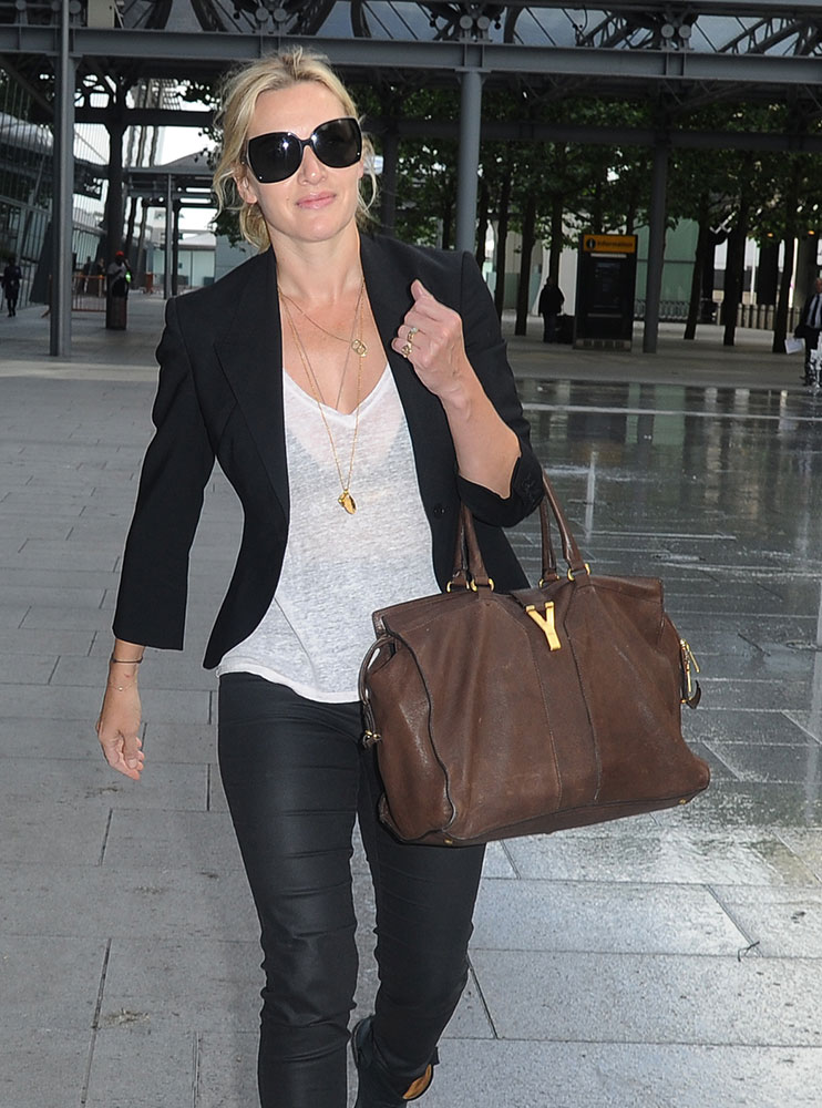 ysl replica clutch - Celebs Travel Internationally with C��line, Saint Laurent, \u0026amp; More ...