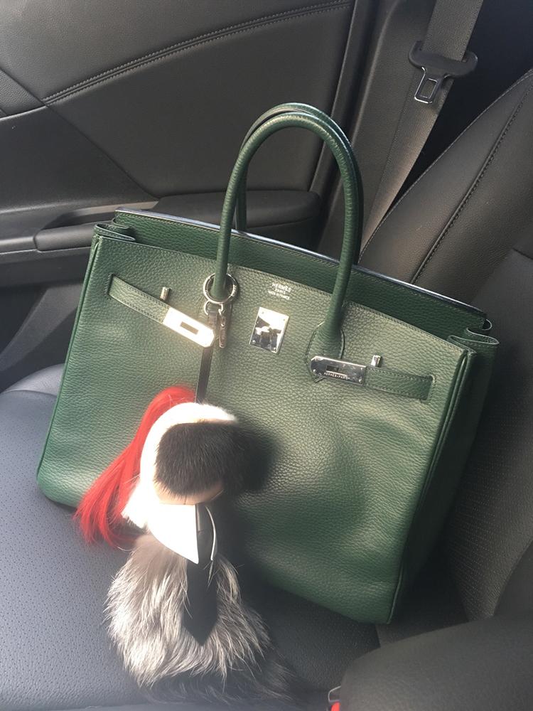 tPF Member: Amozo Bag: Hermès Birkin  Bag Charm: Fendi Karlito Bag Charm Shop bag charm for $1,000 via Neiman Marcus