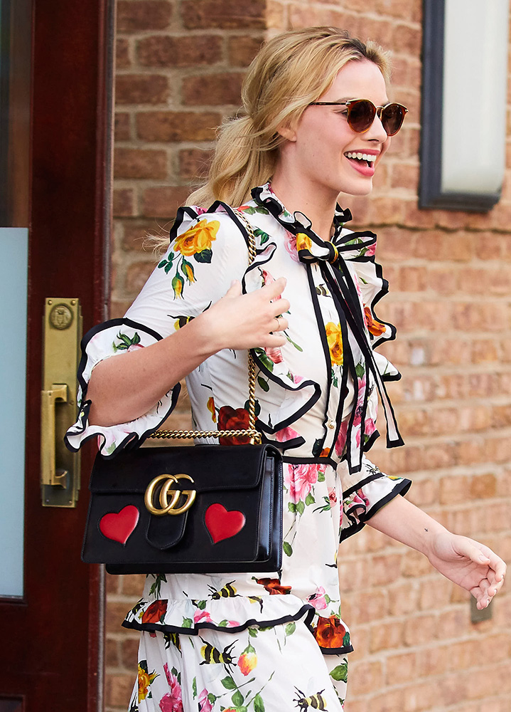 celebs hit the press circuit with bags from gucci  versace  chanel and more