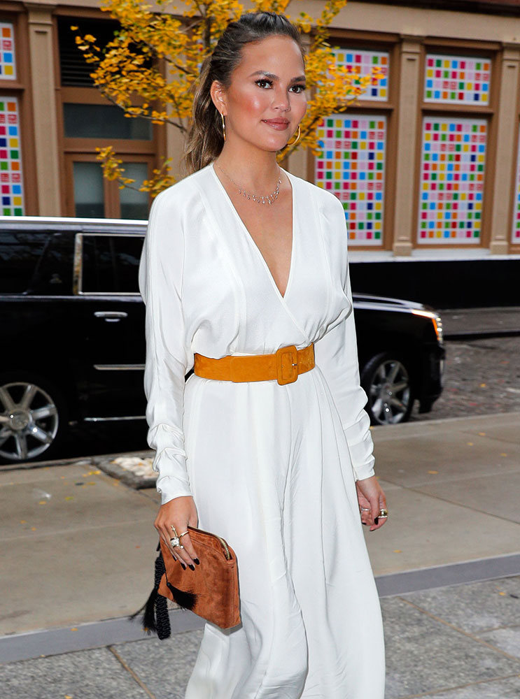 chrissy-teigen-the-row-suede-tassel-wristlet