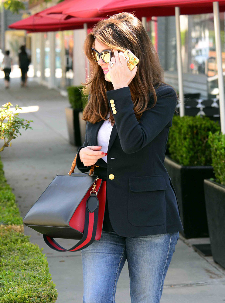 edd236b44e20 Here she is out and about in West Hollywood with an extremely trendy,  bamboo-handled Gucci Nymphea. This style has really taken off with celebs  in the last ...