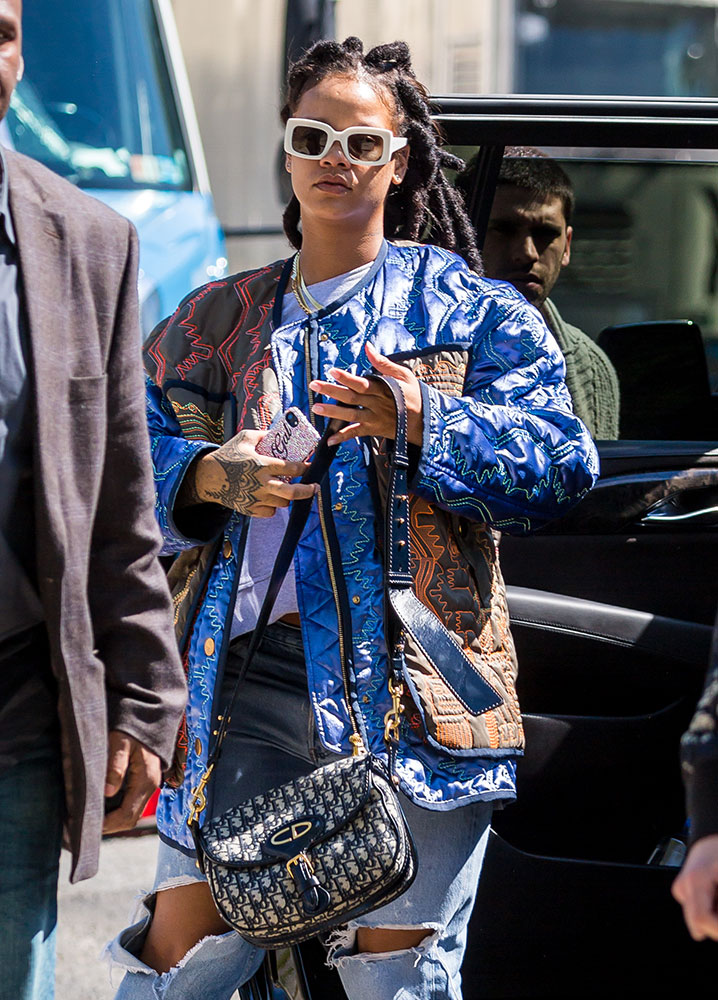 1ec2877b9a ... Rihanna and her Dior Saddle Bag on the set of Ocean's 8. Have you heard  about Ocean's 8? It's an all-female reboot of the Ocean's 11 franchise, ...