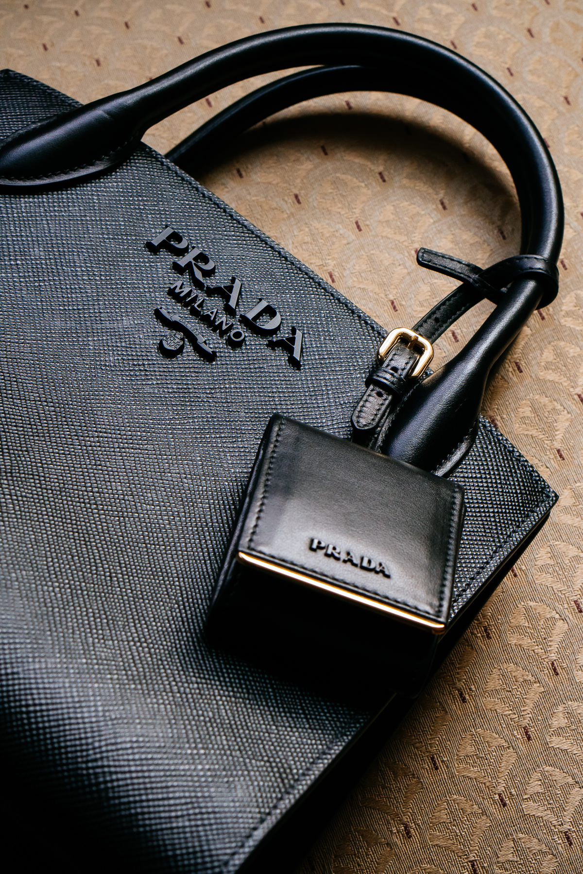 92d289ae5fe4 The monochrome bag is crafted in Prada s signature Saffiano leather and  lined with Prada s signature lining. Inside