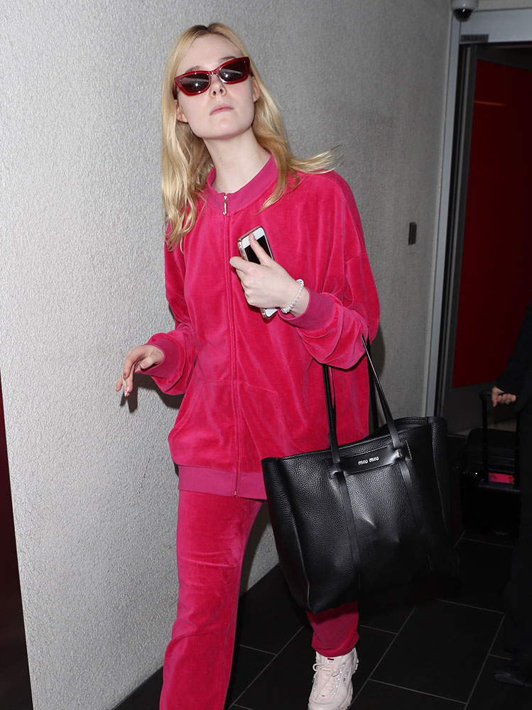 9eac675872d Celebs Weather the Remainders of Winter with Black Bags from Prada ...
