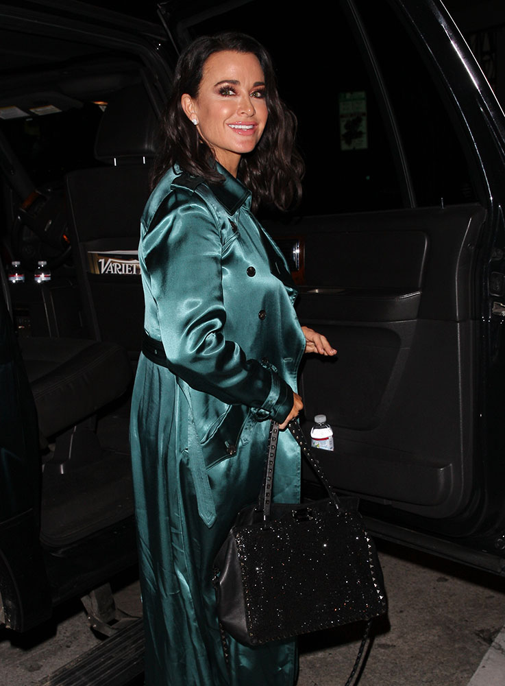 e3bf6480b320 Celebs Choose Black and Gold (or Glittery) Bags from Prada