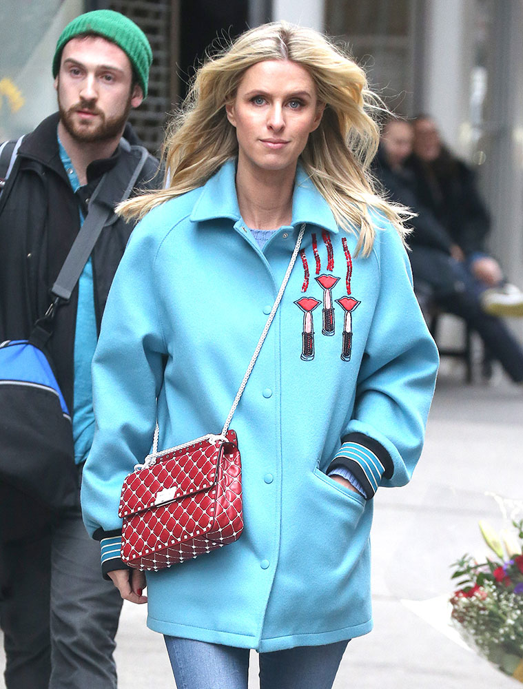 b9905f0d16e7 Just Can t Get Enough  Nicky Hilton Loves Her Red Handbags - PurseBlog