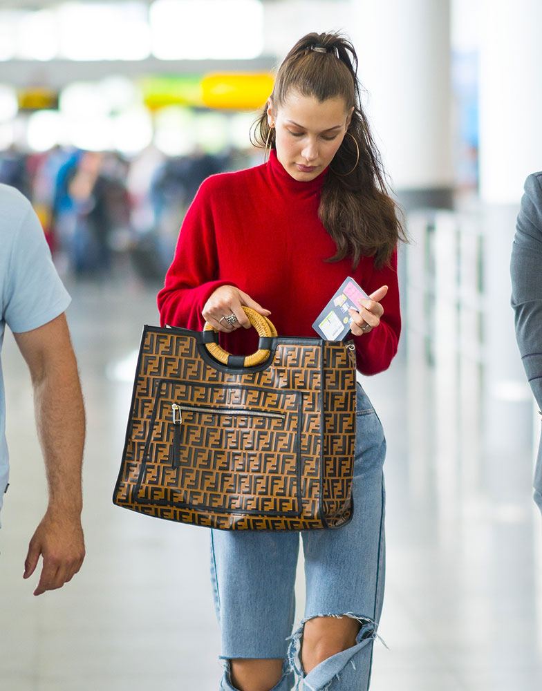 224e0bb6b590ef Bella Hadid is seen here tucking her passport back into her Fendi Runaway  Bag at JFK. This classic shopper tote may look a bit slight here, ...
