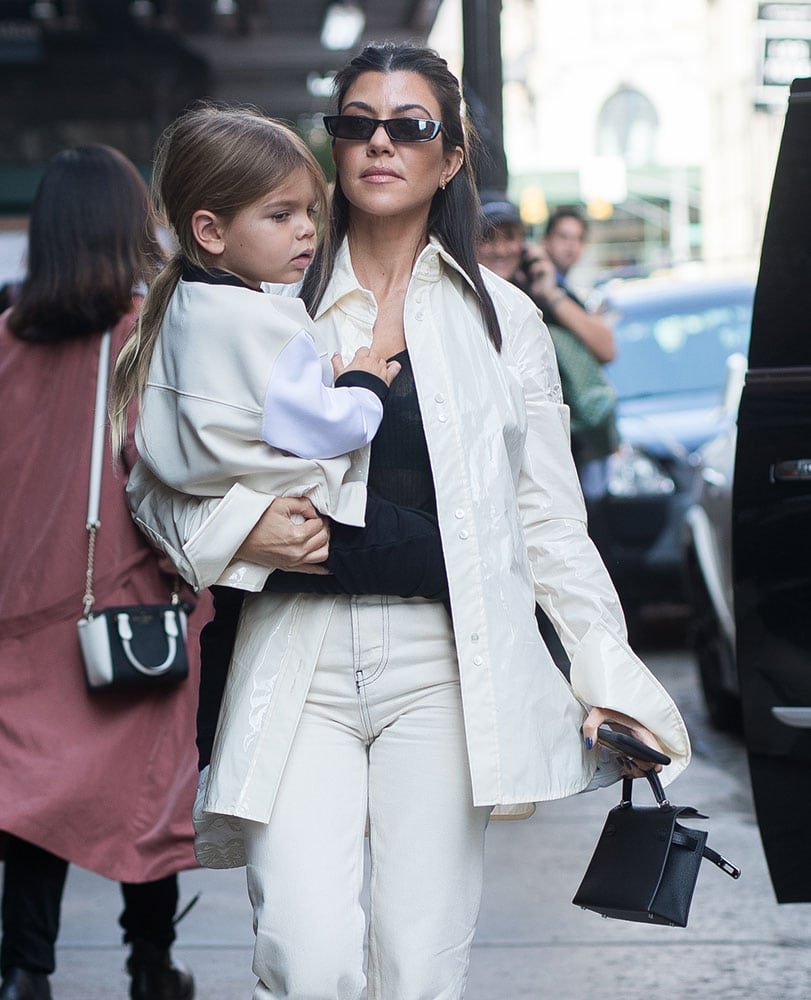 fb0aec09190e50 Kourtney Kardashian was recently spotted carrying a teensy Hermès Kelly Bag  and her youngest son Reign in NYC.