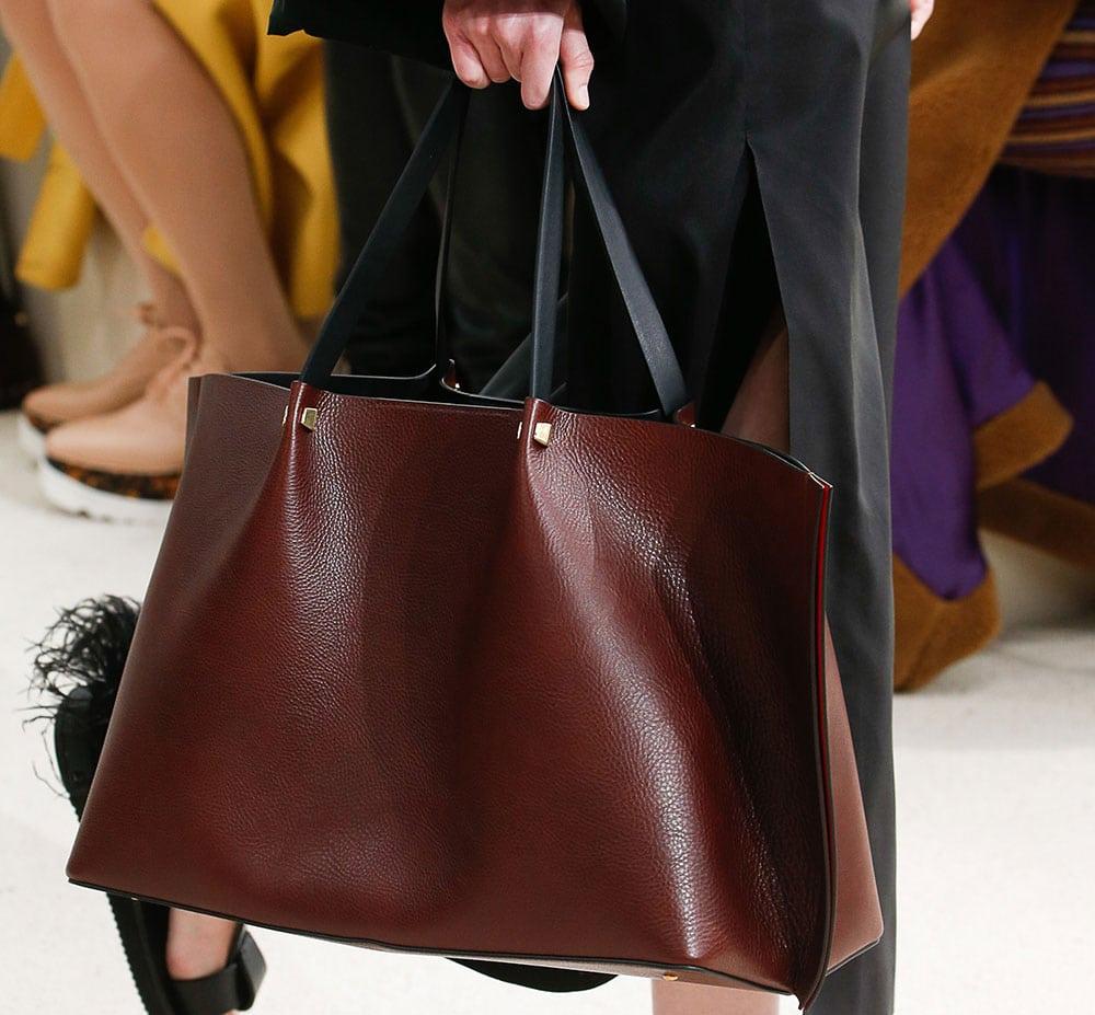 f5e04b98c97 Valentino Bets Big with New Logo Hardware on a Rockstud-Free Handbag ...