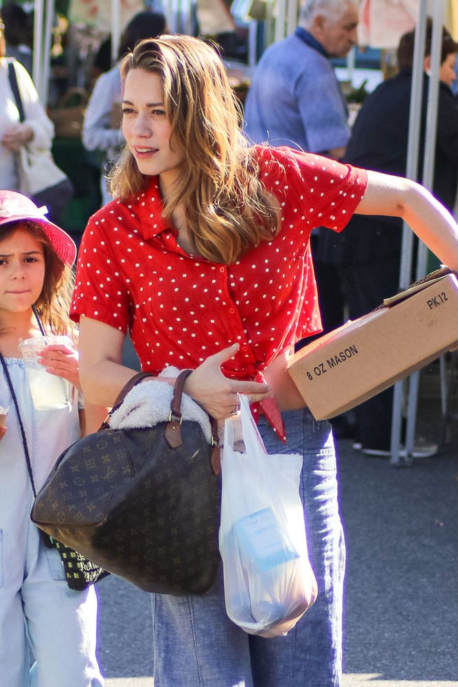 b919e6dad163 Celebs Are Schmoozing Merrily Along with Bags from Prada and Chanel ...