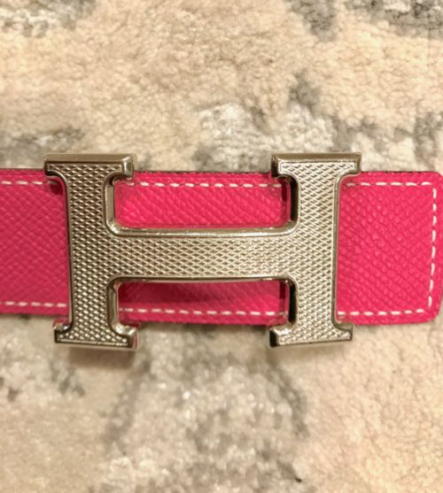 I recommend, if possible, getting a textured buckle such as the guilloche because scratches don't show as much.