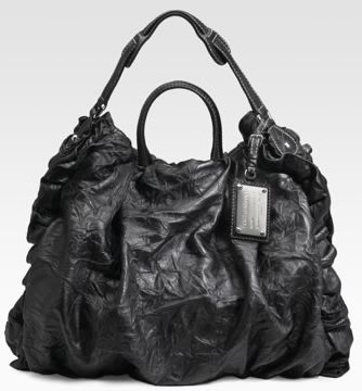 I really want to like the Dolce   Gabbana Miss Rouche Distressed Tote. It s  punky 1dd1f359977b8